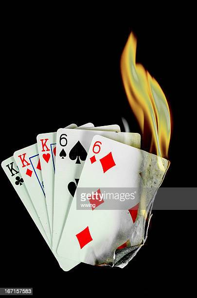 hot card hand... full house - hand of cards stock photos and pictures