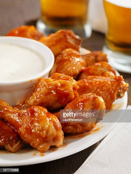 hot chicken wings and beer - chicken wings stock pictures, royalty-free photos & images