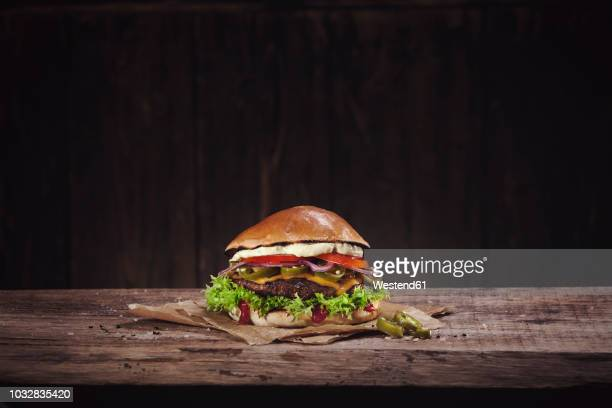 hot chili burger - wax paper stock photos and pictures