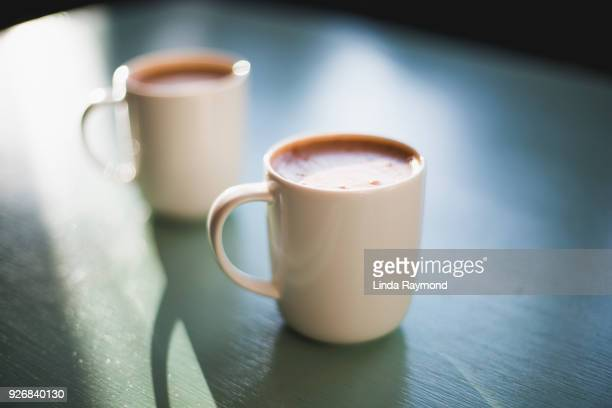 hot chocolat - two objects stock photos and pictures