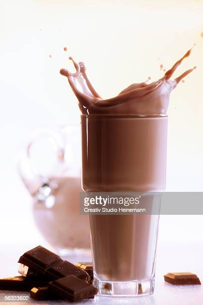 Chocolate milkshake and piece of chocolate, close-up