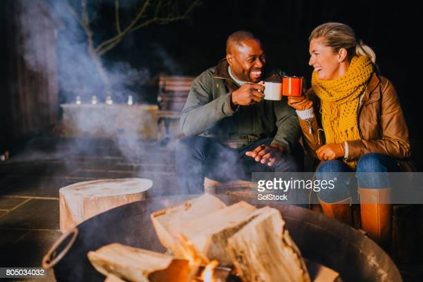 hot chocolate by the fire - fire pit stock pictures, royalty-free photos & images