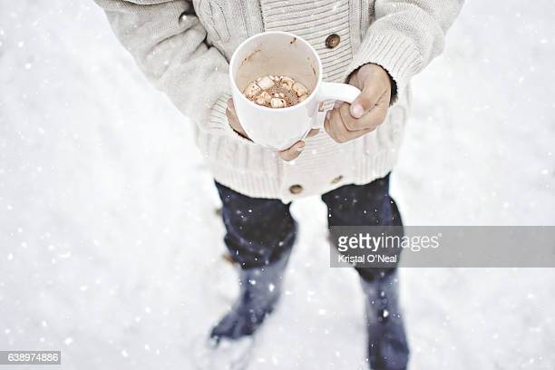 hot chocolate in the snow - snow boot stock photos and pictures