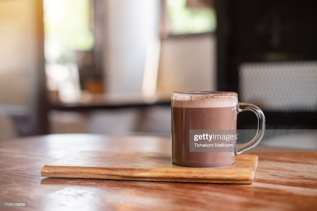 Hot chocolate or cocoa on wooden table , background : Stock Photo