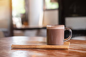 Hot chocolate or cocoa on wooden table , background