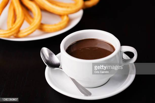 hot chocolate with churros - cris cantón photography fotografías e imágenes de stock
