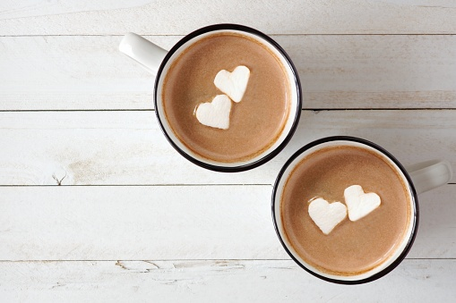 Hot chocolate with heart marshmallows over white wood 903926000
