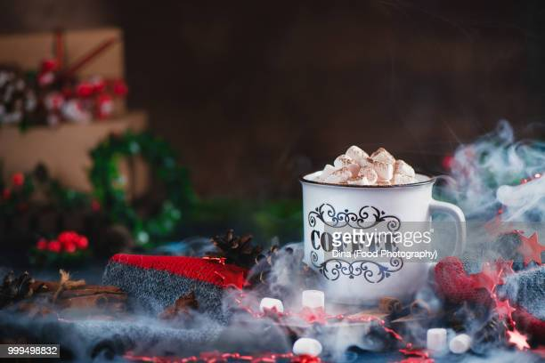 Hot chocolate with marshmallows in a cozy enamel mug with steam