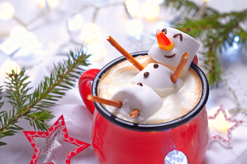 Hot chocolate with melted snowman 497277722