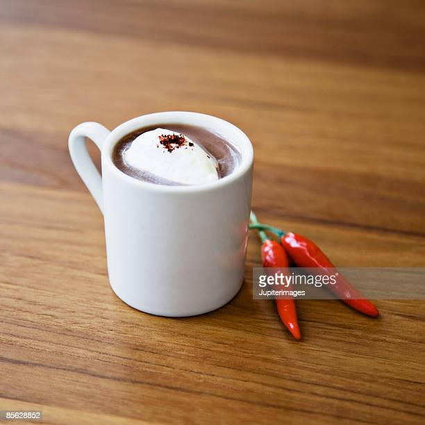 Hot chocolate with whipped cream, chile powder, and chiles