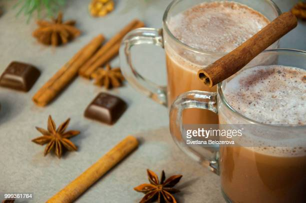 Hot Christmas Drink Cocoa Coffee or Chocolate with Milk Cream in a Small Transparent Cup. Fir...