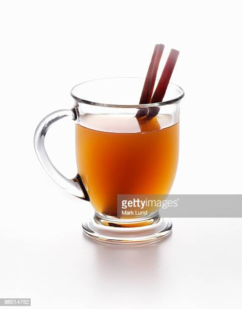Hot Cider in a Mug with Cinnamon Sticks