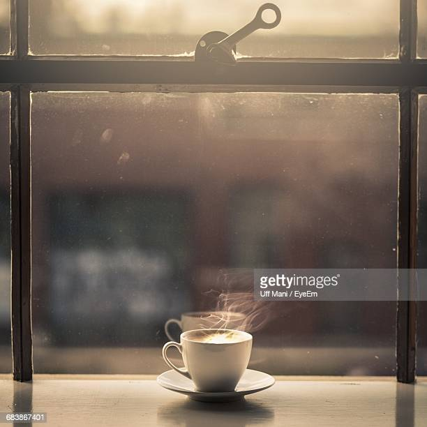 Hot Coffee Cup By Glass Window
