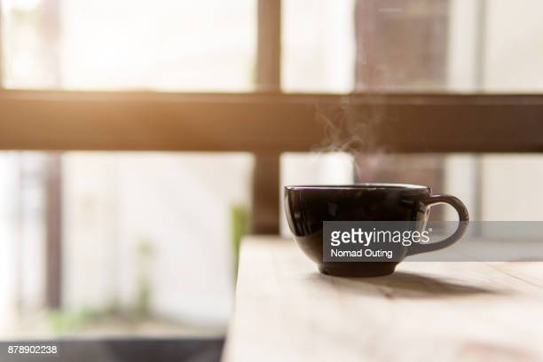 hot coffee cup on table,breakfast beverage in the morning