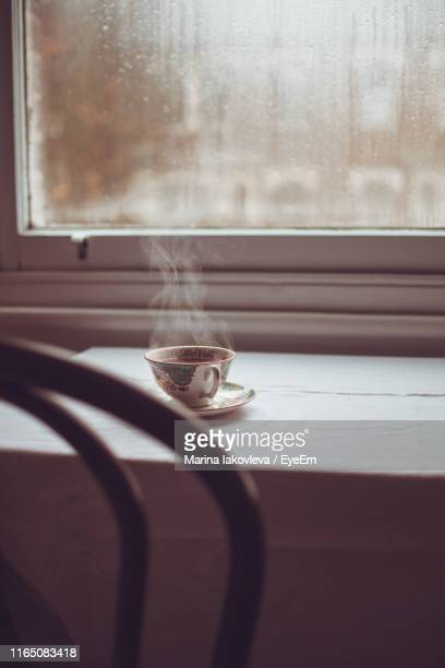 Hot Coffee On Window Sill At Home