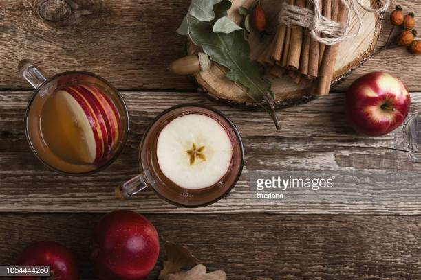 hot cozy autumn and winter drinks with apple slices - cider stock pictures, royalty-free photos & images