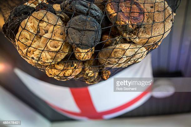 Hot cross buns sit in a net above the bar of the Widow's Son pub in BromleybyBow on April 18 2014 in London England The Widow's Son was built in 1848...