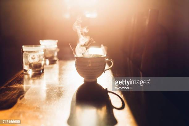 hot cup of tea in the morning light - hot tea stock pictures, royalty-free photos & images