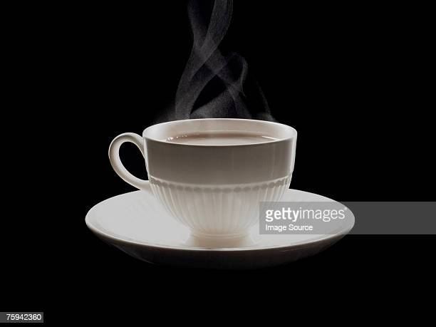 hot cup of tea - saucer stock pictures, royalty-free photos & images