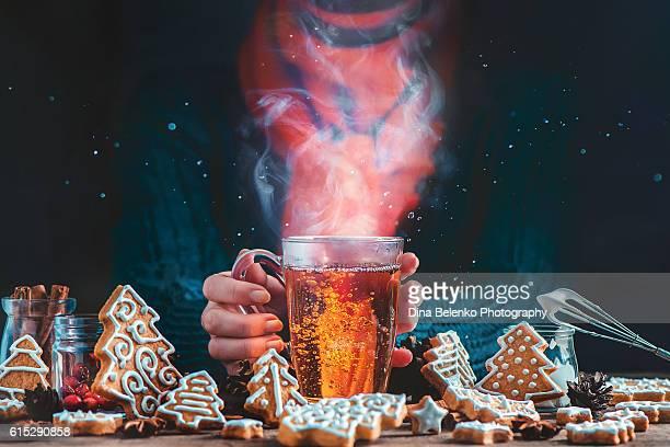 hot cup of tea with christmas cookies - tee warmes getränk stock-fotos und bilder