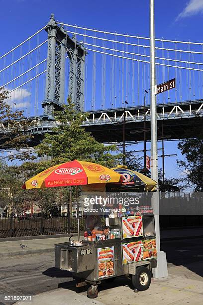 Hot dog cart with Manhattan Bridge