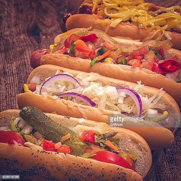 Hot Dog Variation on Wooden Board