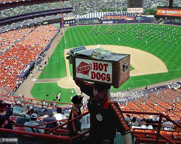 A hot dog vendor makes his rounds at Shea Stadium 31 March before the start of the opening day game of the 1998 baseball season with the New York...