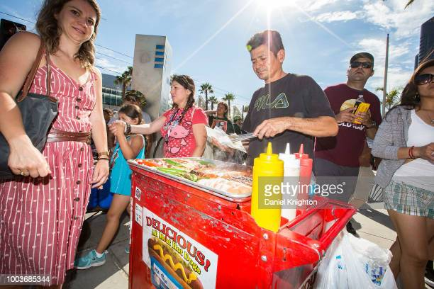 A hot dog vendor serves customers outside ComicCon International on July 21 2018 in San Diego California