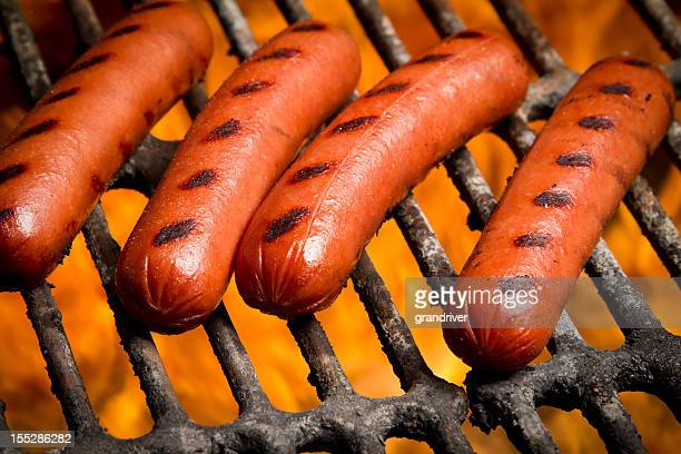 hot dogs on a grill - hot dog stock pictures, royalty-free photos & images