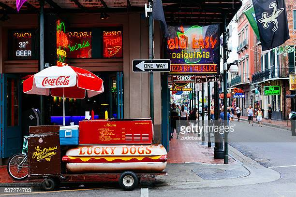 hot dogs stand in bourbon street, new orleans, usa - new orleans stock photos and pictures