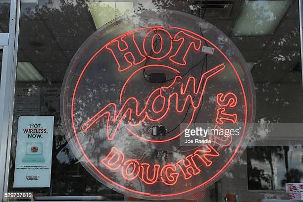 Hot doughnut's now sign is seen at a Krispy Kreme store are seen on May 09, 2016 in Miami, Florida. JAB Holdings Company, announced it is acquiring...