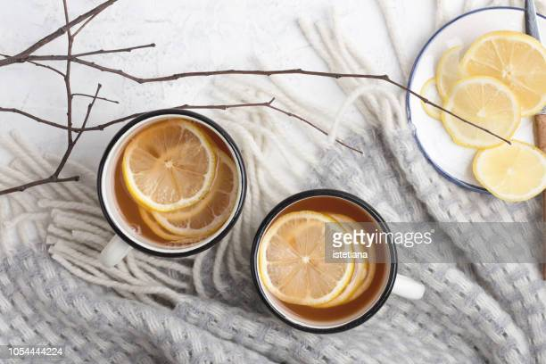 hot drink with lemon slices - hygge stock pictures, royalty-free photos & images