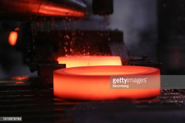 Hot forged bearing components move along a conveyor inside the Schaeffler AG factory in Schweinfurt Germany on Tuesday July 3 2018 Schaeffler the...