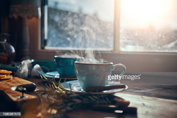 hot fruit tea with oranges and cinnamon - hot tea stock pictures, royalty-free photos & images