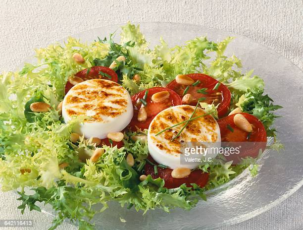Hot goats cheese salad on sliced tomatoes