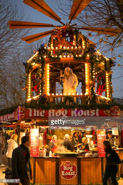 A hot hog roast stall at the German Christmas Market being held on the South Bank on December 13 2013 in London England Running from November 15th to...
