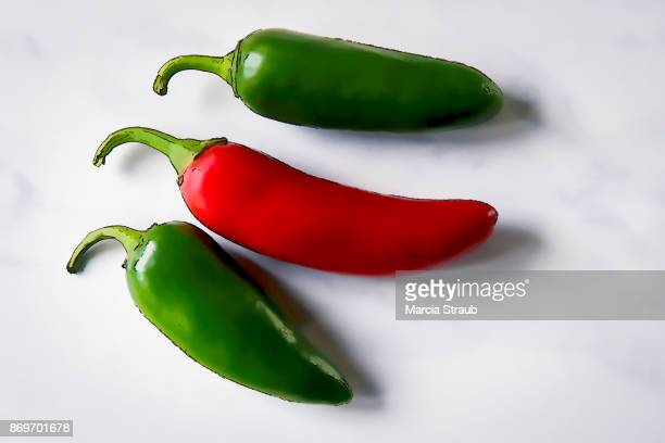 hot jalapeno peppers on white - jalapeno stock-fotos und bilder