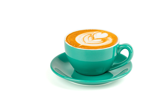 Hot latte coffee with latte art in a green cup isolated on white background with clipping path. 950791138