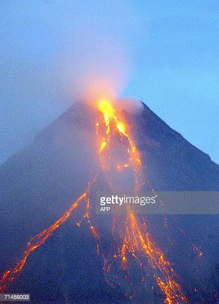Hot lava and steam spew out of Mayon volcano crater before dawn 16 July 2006 during a mild eruption phase as viewed from Legaspi city in Albay...