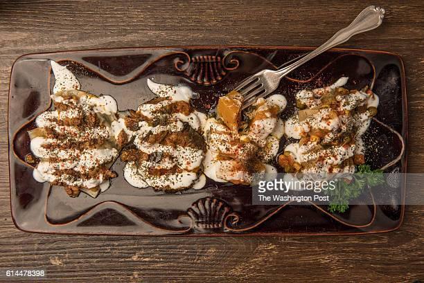 Hot Mazza Assortment Leek Scallion dumpling Roasted eggplant Roasted butternut squash and Spicy beef dumpling at Afghan Bistro