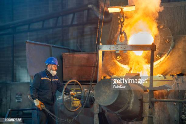 hot metal casting - pbs stock pictures, royalty-free photos & images