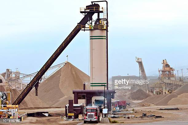 Hot mix is loaded into trucks at Granite Construction Inc's Hot Mix and Aggregate Vernalis plant in Tracy California US on Thursday Dec 2 2010...