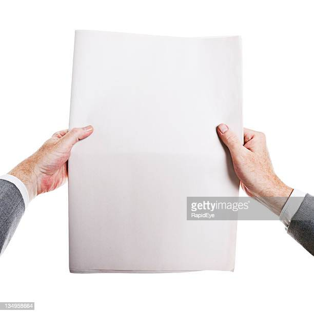 Hot off the press! Man's hands hold blank newspaper.