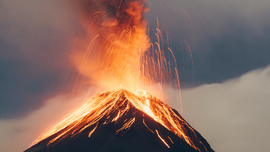 Hot orange lava coming out of fuego volcano 1141550482