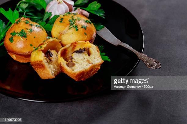 hot pies with mushrooms and garlic on wooden gray boards - crosta di formaggio foto e immagini stock