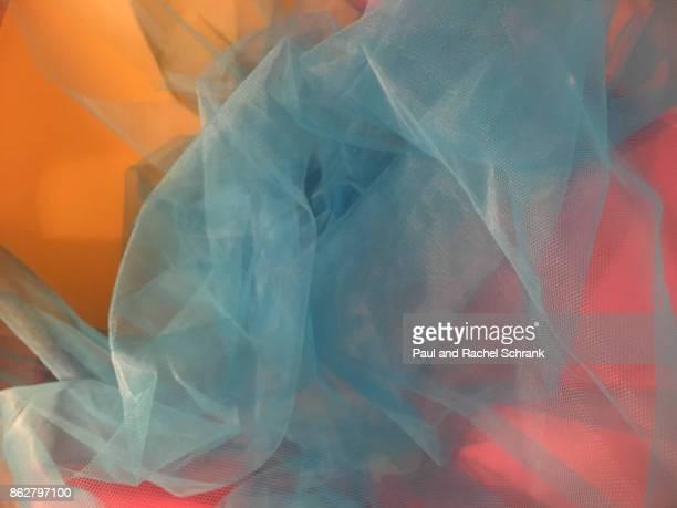 hot pink and yellow with undulating blue - doorzichtige stof stockfoto's en -beelden