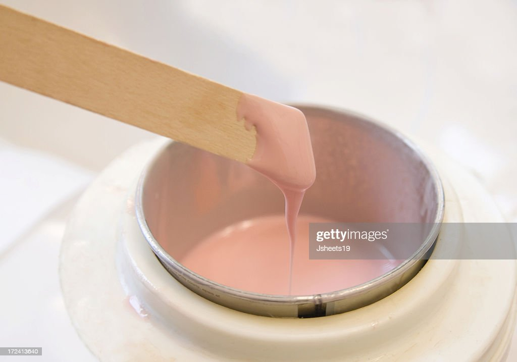 Hot pink wax used for hair removal : Stock Photo