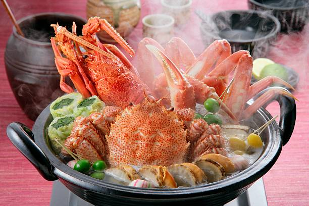 hot pot dish - crab boil stock pictures, royalty-free photos & images