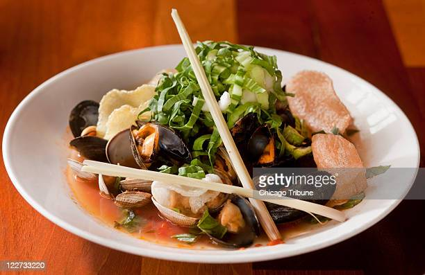 A hot pot of mussels clams and baby bok choy is featured at Roots Restaurant in Milwaukee Wisconsin