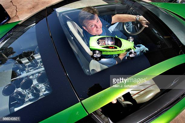 Hot Rod designer Chip Foose sits in his Hemisfear hot rod at his Huntington Beach Foose Design business Foose is one of the top car customizers and...